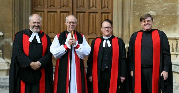 Fr. Robert first on left